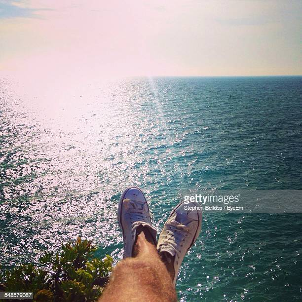 Mans Legs Against Sea