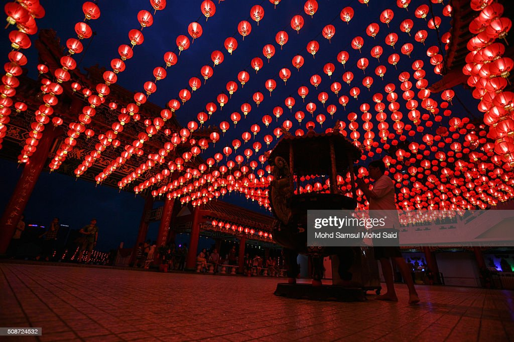 A man's perform a prayer inside the Thean Hou temple with lanterns decorated ahead of Lunar New Year of the monkey celebrations on February 6, 2016 in Kuala Lumpur, Malaysia. According to the Chinese Calendar, the Lunar New Year which falls on February 8 this year marks the Year of the Monkey, the Chinese Lunar New Year also known as the Spring Festival is celebrated from the first day of the first month of the lunar year and ends with Lantern Festival on the Fifteenth day.