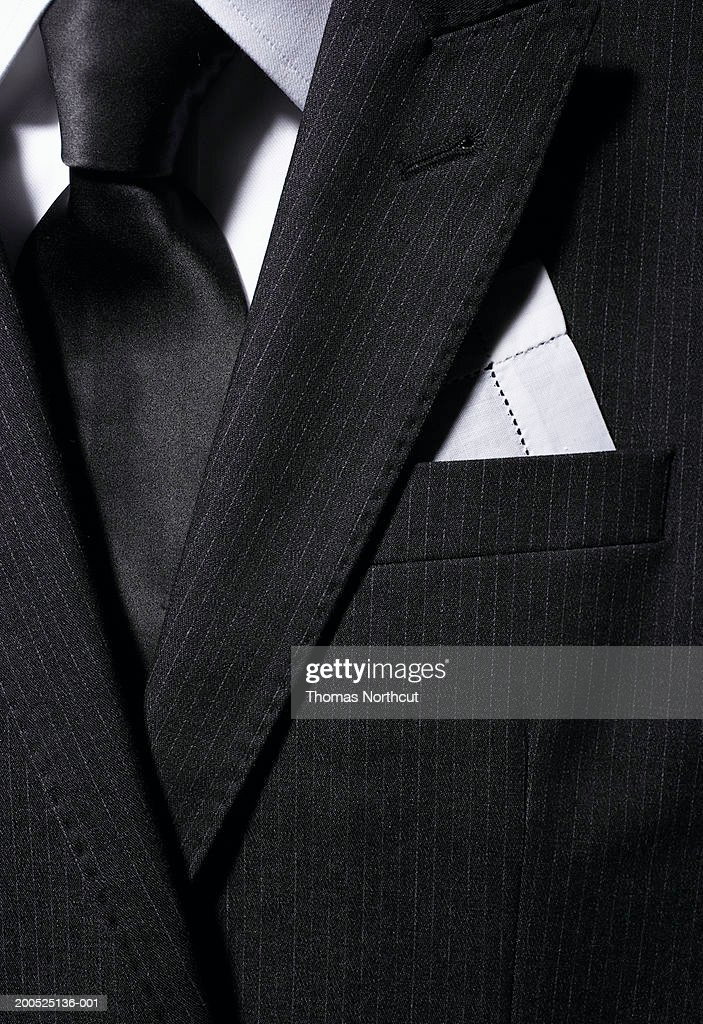 Man's pinstripe suit jacket with tie and pocket square