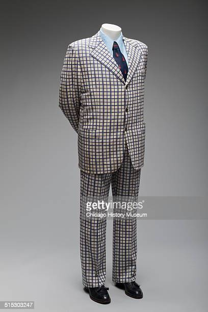 Man's plaid polyster twopiece suit designed by Lawrence Pucci and shown with tie by Blanford and prop shirt 1976 Shown as part of the Chicago History...