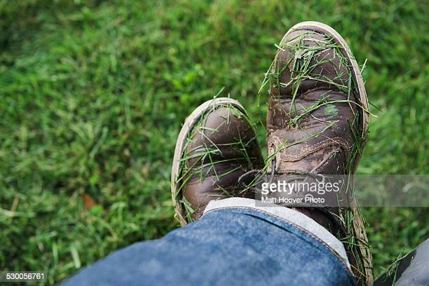 Mans shoes covered in freshly mown grass