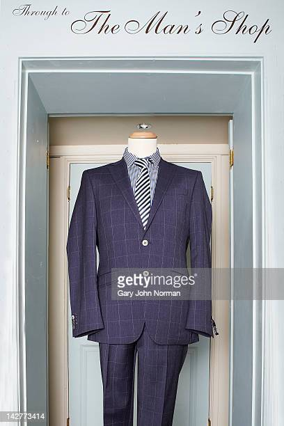 Man's suit on mannequin in Boutique shop