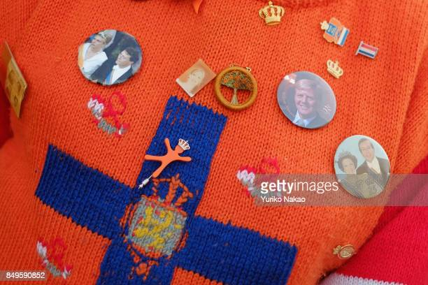 A man's sweater with brooches of the Dutch King WillemAlexander Queen Maxima and other royal families is pictured ahead of the Prinsjesdag in front...