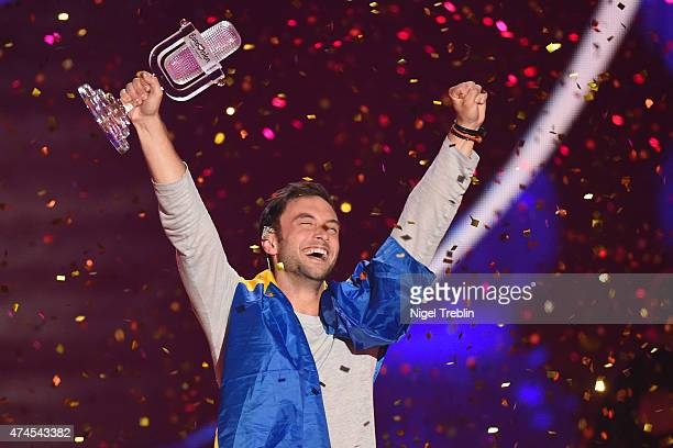 Mans Zelmerloew of Sweden reacts after winning on stage during the final of the Eurovision Song Contest 2015 on May 23 2015 in Vienna Austria The...