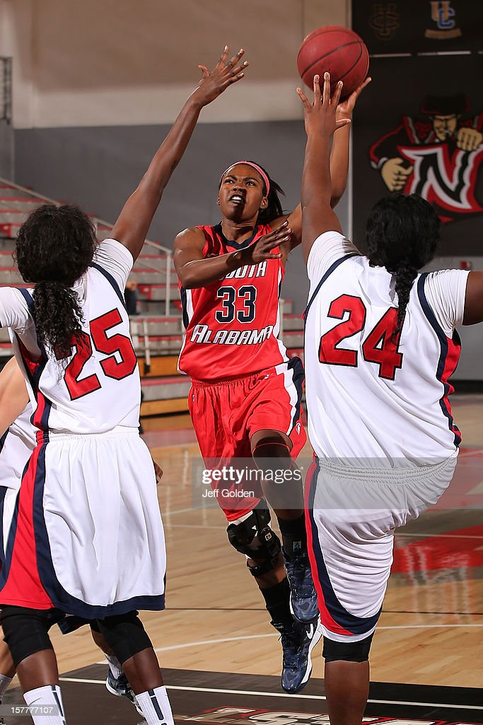Mansa El #33 of the South Alabama Jaguars shoots a layup against Yar Shayok #25 and Shareta Brown #24 of the Detroit Titans at The Matadome on November 24, 2012 in Northridge, California. South Alabama defeated Detroit 59-56.
