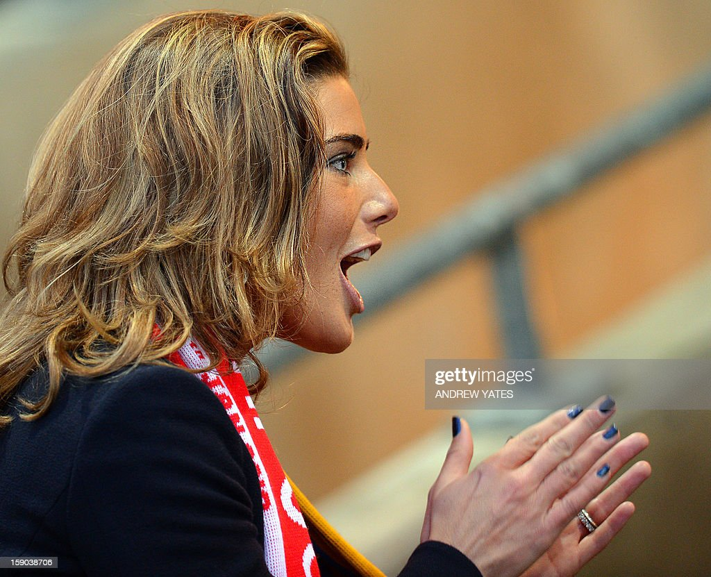 "Mansfied CEO Carolyn Radford cheers during the FA Cup third round football match between Mansfield Town and Liverpool in Mansfield, central England, on January 6, 2013. Liverpool won the match 2-1. USE. No use with unauthorized audio, video, data, fixture lists, club/league logos or ""live"" services. Online in-match use limited to 45 images, no video emulation. No use in betting, games or single club/league/player publications."