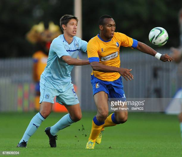 Mansfield Town's Calvin Andrews and Coventry City's Jack Finch battle for the ball