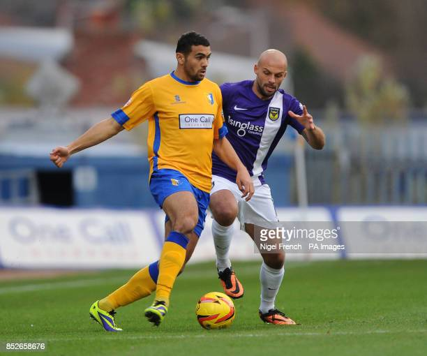 Mansfield Town's Colin Daniel and Oxford United's David Hunt battle for the ball during the Sky Bet League two match at Field Mill Mansfield