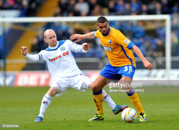 Mansfield Town's Colin Daniel and Rochdale's Peter Cavanagh battle for the ball