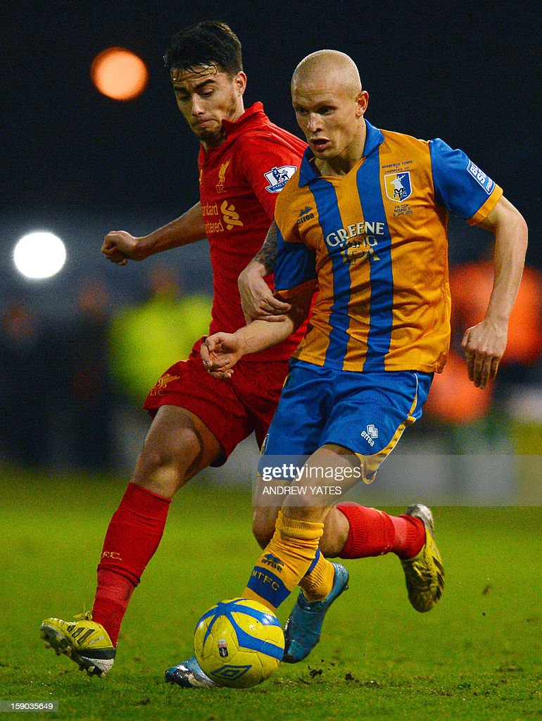 "Mansfield Town's English midfielder Lindon Meikle (R) vies with Liverpool's Spanish forward Suso during the FA Cup third round football match between Mansfield Town and Liverpool at Field Mill in Mansfield, central England, on January 6, 2013. AFP PHOTO/ANDREW YATES USE. No use with unauthorized audio, video, data, fixture lists, club/league logos or ""live"" services. Online in-match use limited to 45 images, no video emulation. No use in betting, games or single club/league/player publications."