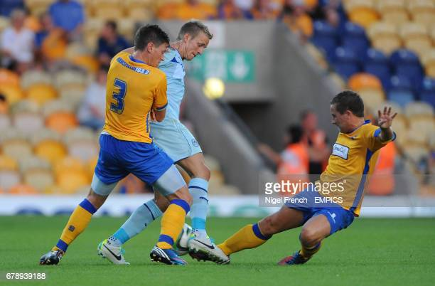 Mansfield Town's James Jennings and Jamie McGuire challenge Coventry City's Carl Baker for the ball