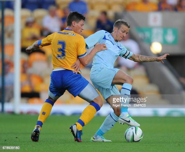 Mansfield Town's James Jennings challenges Coventry City's Carl Baker for the ball