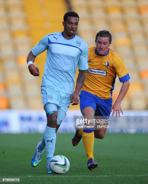 Mansfield Town's Jamie McGuire and Coventry City's Cyrus Christie battle for the ball