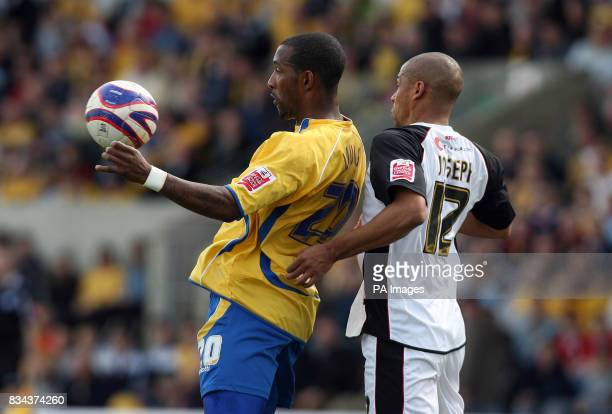 Mansfield Town's Jefferson Louis and Rotherham United's Marc Joseph battles for the ball during the CocaCola Football League Two match at Field Mill...