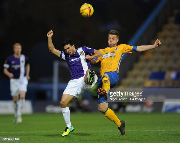 Mansfield Town's Lee Stevenson and Oxford United's Danny Rose battle for the ball during the Sky Bet League two match at Field Mill Mansfield