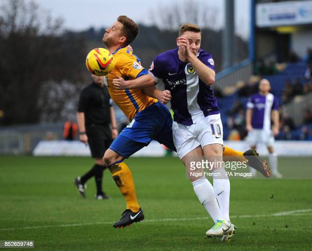 Mansfield Town's Lee Stevenson and Oxford United's Dean Smalley battle for the ball during the Sky Bet League two match at Field Mill Mansfield