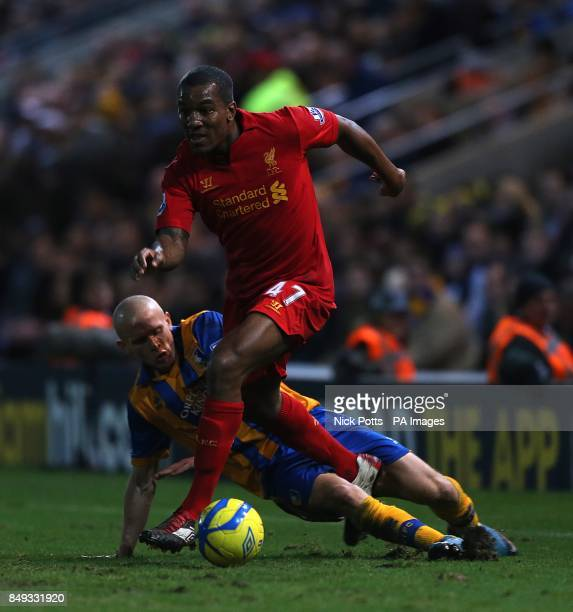 Mansfield Town's Lindon Meikle and Liverpool's Andre Wisdom battle for the ball