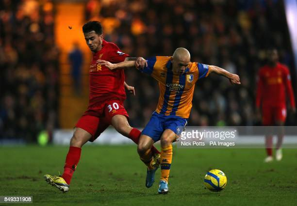 Mansfield Town's Lindon Meikle and Liverpool's Jesus Fernandez Saez battle for the ball