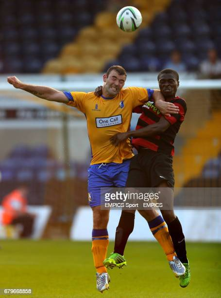Mansfield Town's Matt Rhead tussles for ball with Peterborough United's Gabriel Zakuani