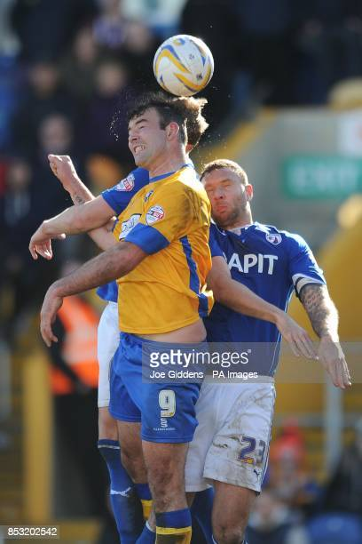 Mansfield Town's Matt Rhead wins a header from Chesterfield's Liam Cooper and Ian Evatt during the Sky Bet League Two match at the One Call Stadium...