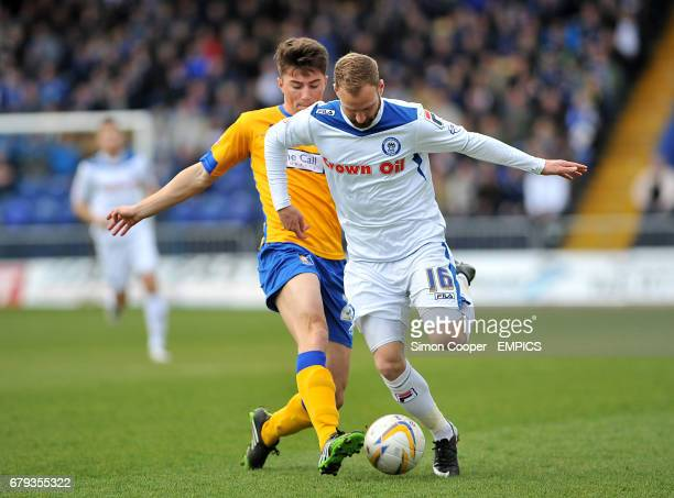 Mansfield Town's Richite Sutton and Rochdale's Matt Done battle for the ball