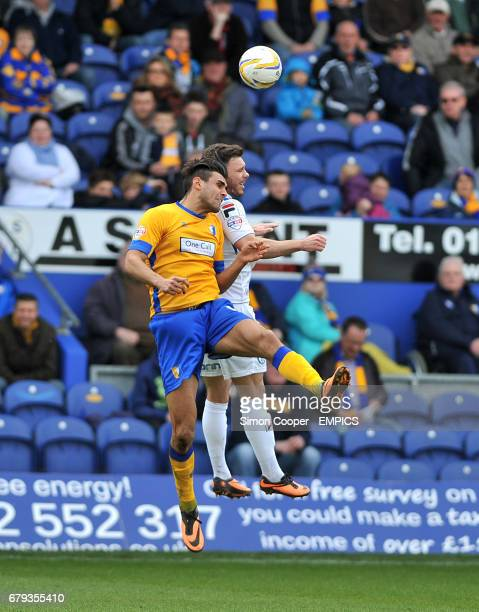 Mansfield Town's Ryan Tafazolli and Rochdale's Scott Hogan battle for the ball