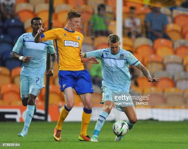 Mansfield Town's Sam Clucas v Coventry City's Carl Baker battle for the ball