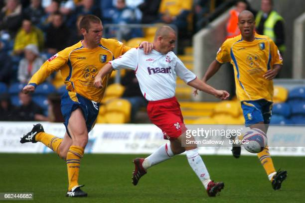 Mansfield Town's Stephen Dawson and Lincoln City's Jamie Forrester in action