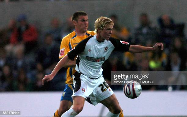 Mansfield Town's Stephen Dawson and Rotherham United's Ryan Taylor in action
