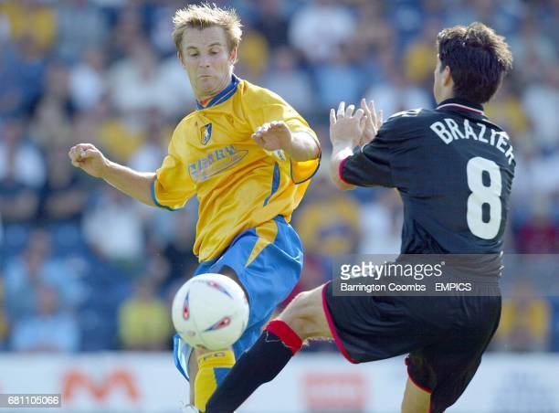 Mansfield Town's Tom Curtis and Leyton Orient's Matthew Brazier battle for the ball