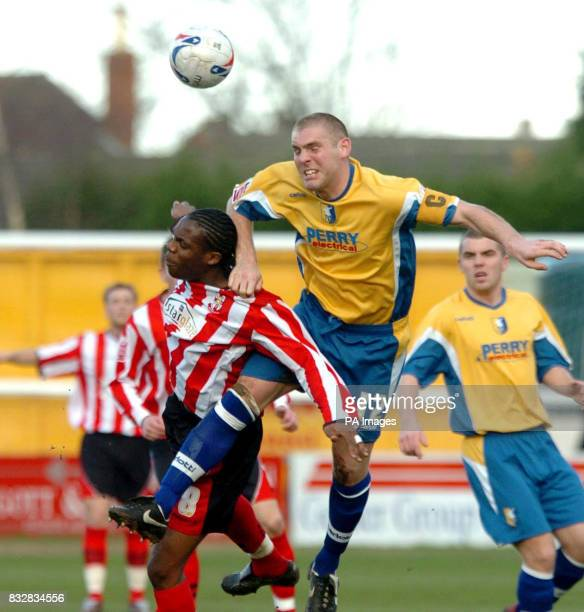 Mansfield's Jake Buxton in action against Lincoln's Dany N'Guessan during the CocaCola Football League Two match at Sincil Bank Lincoln