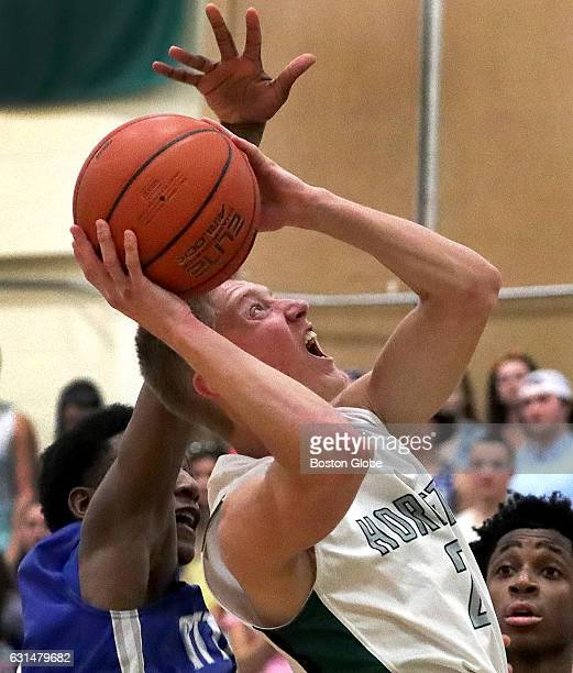 Mansfield's Max Boen is fouled as he drives to the hoop against Attleboro Mansfield hosts Attleboro in a boys' high school basketball matchup of...