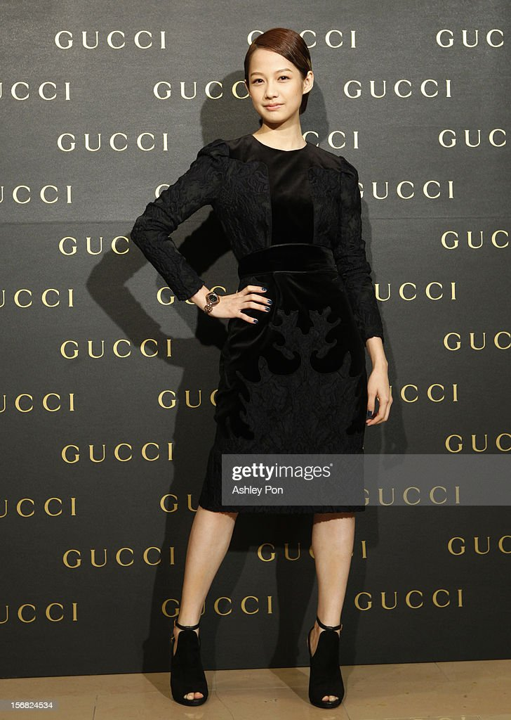 Man-Shu Jian poses for a photograph at the Gucci Flagship store opening at Taipei101 on November 22, 2012 in Taipei, Taiwan.