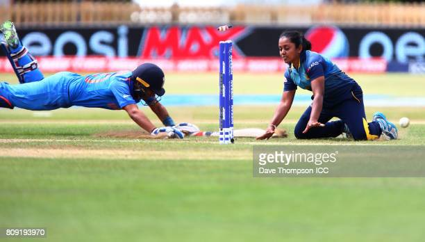 Mansi Joshi of India is run out by Chandima Gunaratne of Sri Lanka during the ICC Women's World Cup match between Sri Lanka and India at The 3aaa...