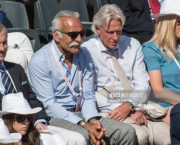 Mansour Bahrami and Bjorn Borg attend the french open at Roland Garros on June 7 2015 in Paris France