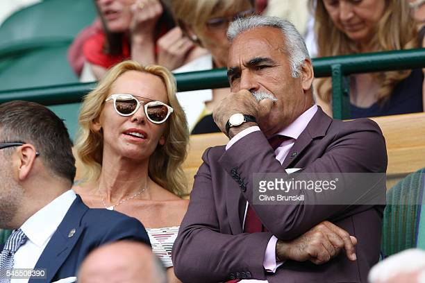 Mansour Bahrami and Dawn McDaniel watch on as Roger Federer of Switzerland plays Milos Raonic of Canada in the Men's Singles Semi Final match on day...
