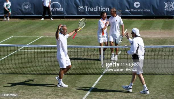 Mansour Bahrami and Ille Nastase celebrate beating Peter McNamara and Michael Pernfors in their double's match