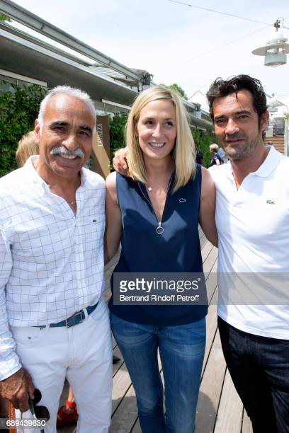 Mansour Bahrami CEO Lacoste Thierry Guibert and his wife Cindy attend the 2017 French Tennis Open Day One at Roland Garros on May 28 2017 in Paris...