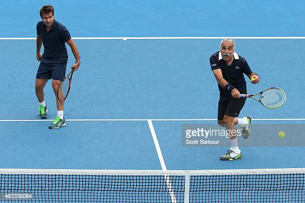 Mansour Bahrami of Iran and Fabrice Santoro of France in action in their legends doubles match during day eight of the 2015 Australian Open at...