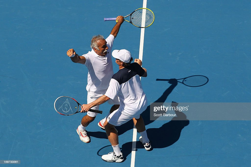 Mansour Bahrami of Iran and Wayne Ferreira of South Africa celebrate a point in their third round legends match against Jacco Eltingh and Paul Haarhuis of the Netherlands during day seven of the 2013 Australian Open at Melbourne Park on January 20, 2013 in Melbourne, Australia.