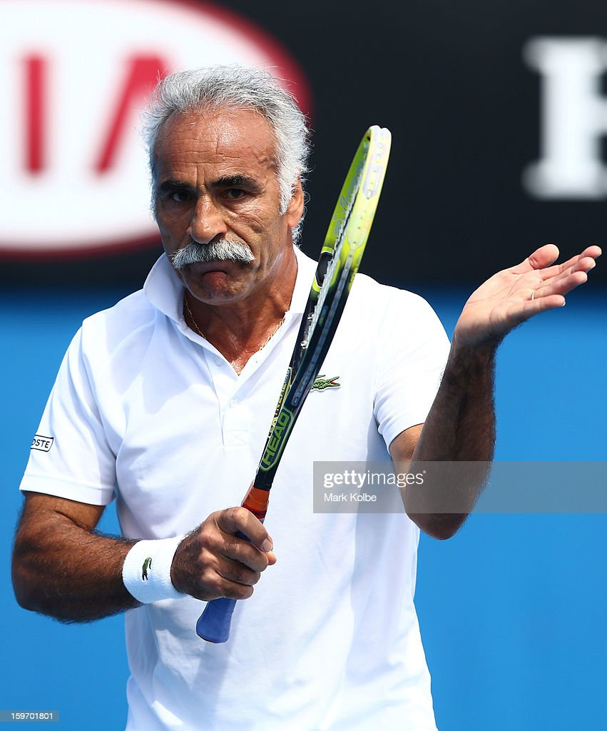 Mansour Bahrami of Iran applauds in his legends doubles round one match with Wayne Ferreira of South Africa against Mark Woodforde of Australia and Todd Woodbridge of Australia during day six of the 2013 Australian Open at Melbourne Park on January 19, 2013 in Melbourne, Australia.