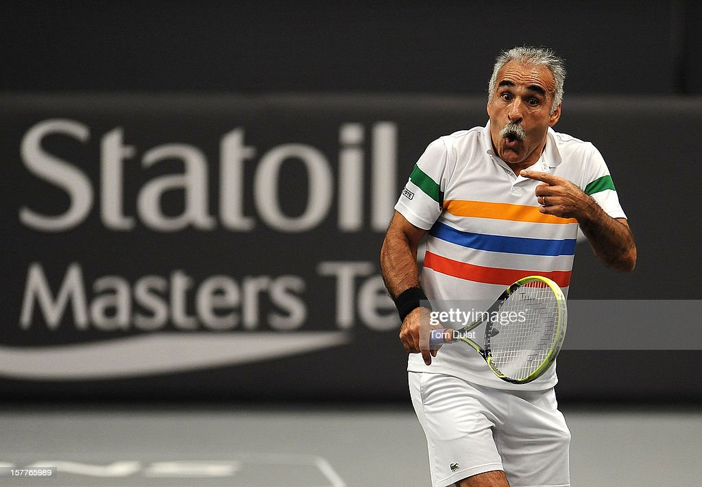 <a gi-track='captionPersonalityLinkClicked' href=/galleries/search?phrase=Mansour+Bahrami&family=editorial&specificpeople=178975 ng-click='$event.stopPropagation()'>Mansour Bahrami</a> of Iran during match against Wayne Ferreira of South Africa and Peter McNamara of Australia on Day Two of the Statoil Masters Tennis at the Royal Albert Hall on December 6, 2012 in London, England.