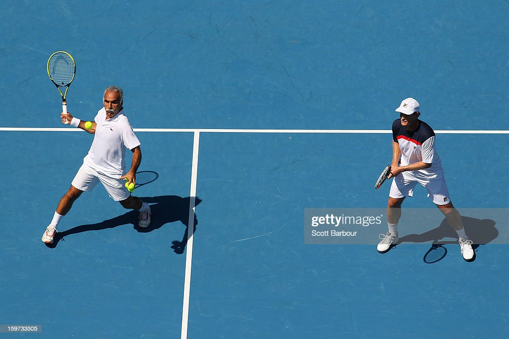 Mansour Bahrami of Iran plays a shot in his third round legends match with Wayne Ferreira of South Africa against Jacco Eltingh and Paul Haarhuis of the Netherlands during day seven of the 2013 Australian Open at Melbourne Park on January 20, 2013 in Melbourne, Australia.