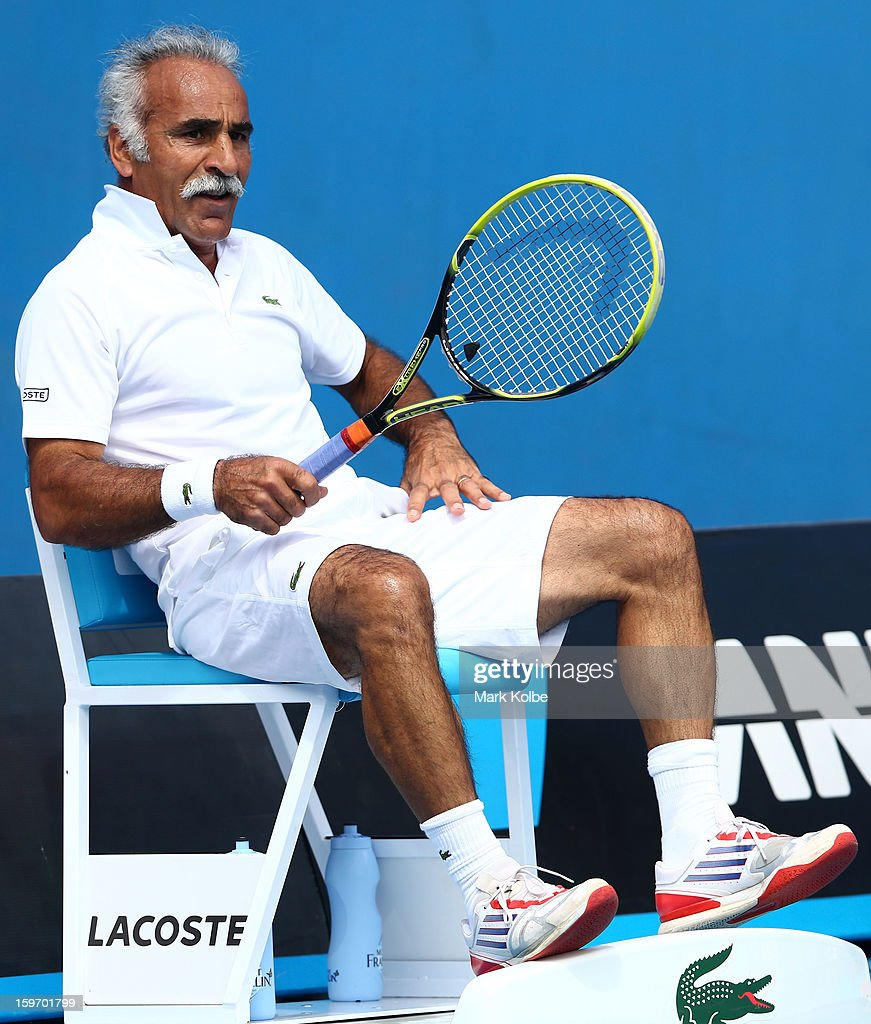 Mansour Bahrami of Iran sits on an official's chair in his legends doubles round one match with Wayne Ferreira of South Africa against Mark Woodforde of Australia and Todd Woodbridge of Australia during day six of the 2013 Australian Open at Melbourne Park on January 19, 2013 in Melbourne, Australia.