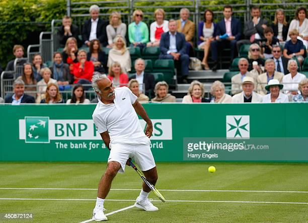 Mansour Bahrami plays a trick shot during his Men's Doubles exhibition match against Pat Cash and Peter McNamara at the BNP Paribas Tennis Classic at...