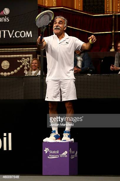Mansour Bahrami plays a trick shot during the Legends Exhibition Doubles match between Tim Henman and Andrew Castle against Mansour Bahrami and Wayne...