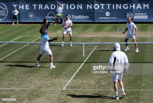 Mansour Bahrami receives the help of a child on his sholder's to return the ball back during his double's match with his partner Ille Nastase and...