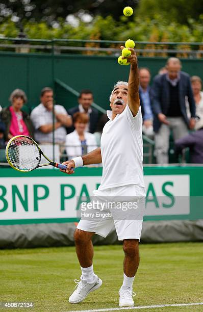 Mansour Bahrami serves during his Men's Doubles exhibition match against Pat Cash and Peter McNamara at the BNP Paribas Tennis Classic at the...