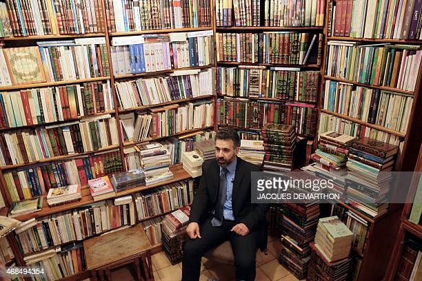 Mansour Mansour director of Dar Albouraq editions poses for a photograph at the 'Librairie de l'Orient' bookstore in Paris on March 31 2015 As sales...