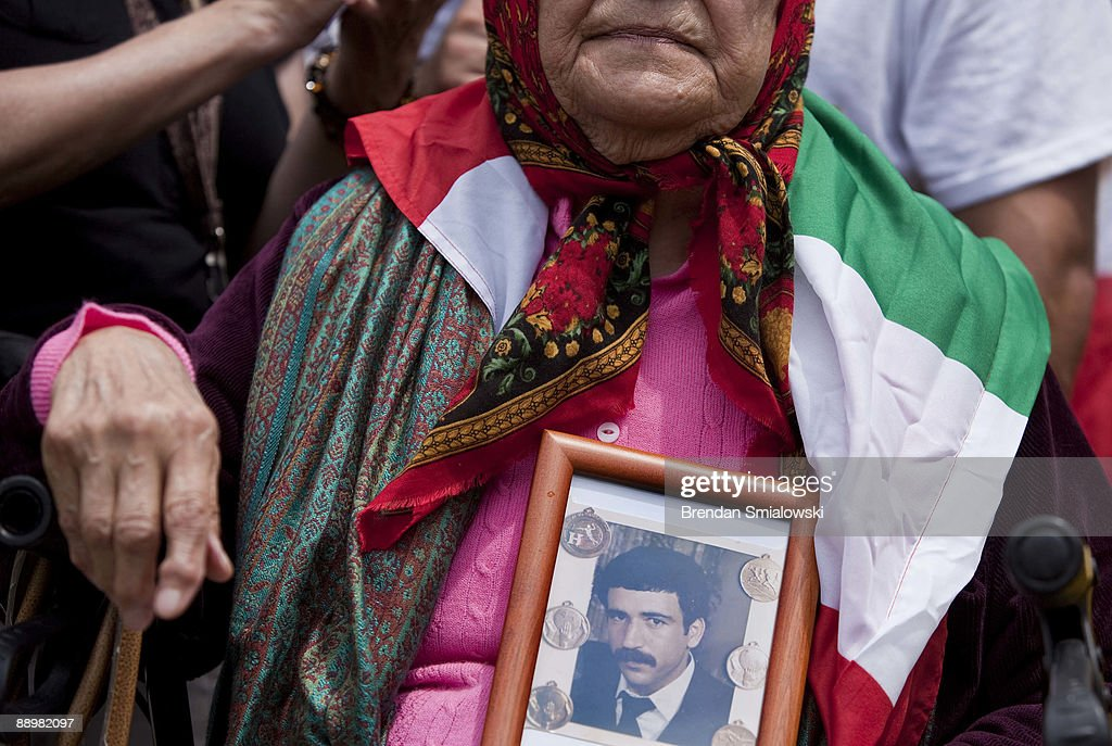 Mansureh Mogedpur, a 78 year old woman who lives in the DC area, holds a photo of her son who she said, through an interpreter, was killed at 27 by the current Iranian regime during a rally July 11, 2009 in Washington, DC. Activists gathered to rally for the current uprising in Iran over the recent elections.